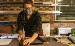 """Craft Shop Coordinator, Stephanie Dukat, glues frame pieces together on Sept. 23, 2020 in the Frame Shop located in the SIU Student Center. """"The craft shop is a creative space for people in students, staff, community members to come in and have a space to make and create things,"""" Dukat said."""