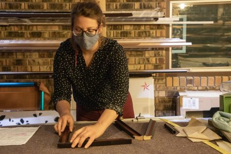 "Craft Shop Coordinator, Stephanie Dukat, glues frame pieces together on Sept. 23, 2020 in the Frame Shop located in the SIU Student Center. ""The craft shop is a creative space for people in students, staff, community members to come in and have a space to make and create things,"" Dukat said."
