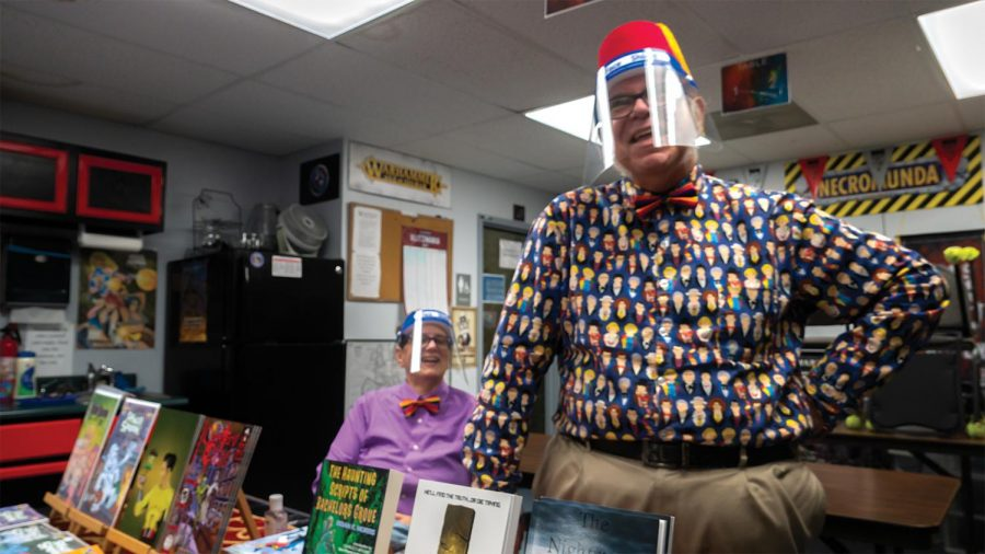 """Author, Brian K. Morris (right) and wife, Cookie Morris (left) discuss their time in the publishing industry at Castle Perilous Games and Books' Halloween Comicfest Saturday, Oct. 31, 2020, in Carbondale, Ill. """"I used to make up my own stories when I was about 5 and 6 years old. As I grew I got into comic books and I wanted more stuff and they weren't putting them out at the time, so I started to make my own adventures,"""" Morris said. The Morris family appeared at Castle Perilous' Halloween Comicfest to promote Brian's work and to celebrate Halloween with the store patrons."""