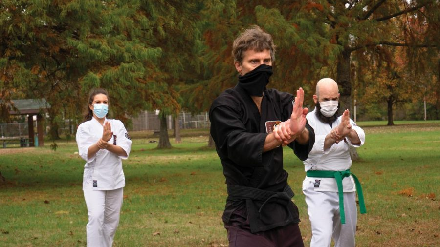 "Chris Wissmann (middle) teaches a Karate demonstration with students, Rossana Lausell (left) and Isaac Lausell (Right) at the Southern Illinois Unity Coalition's Stop the Violence event held at Attucks Park Saturday, October 24, 2020, in Carbondale, Ill. ""We came out to support Sensei Wissmann which is one of our two Karate teachers at the park district. I started with Shotokan, which I still practice with Sensei Everheart at SIU but with Sensei Wissmann I've been training for a year and a half,"" Issac Lausell said."