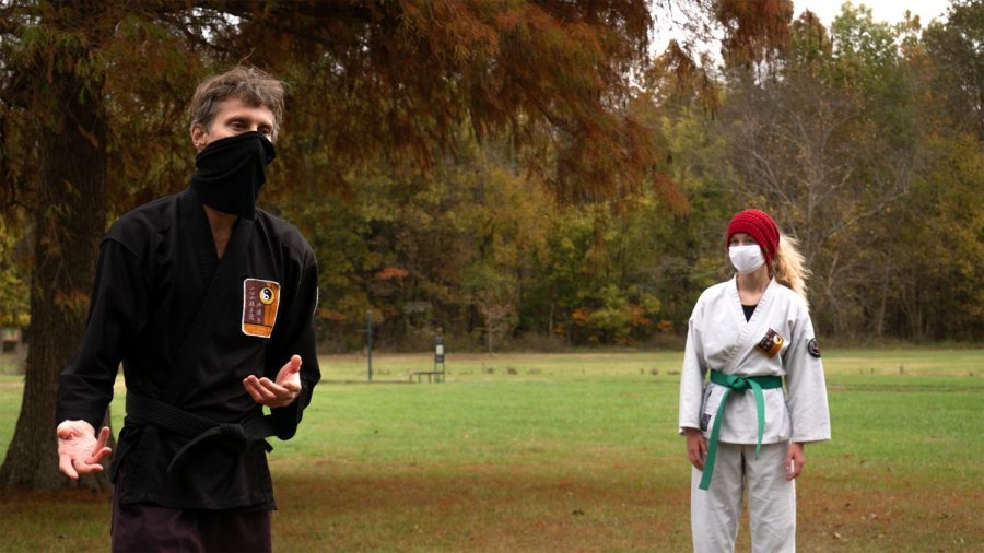 """Chris Wissmann rests with student Katie Herzog after a karate demonstration held by the Southern Illinois Unity Coalition's Stop the Violence event at Attucks Park Saturday, October 24, 2020, in Carbondale, Ill. """"I wanted to be able to demonstrate the part that martial arts can play in non-violence,"""" Herzog said. """"I've been really blessed to have great instruction and it's a joy to pass that on to other people,"""" Wissmann said."""