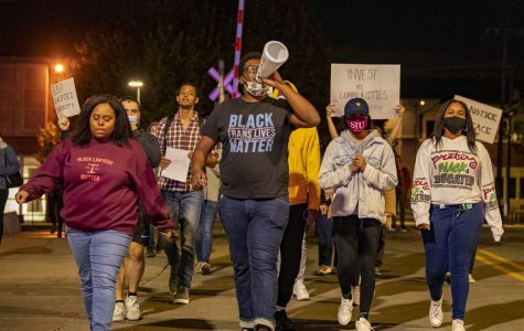 Michael Coleman and Jerricha Griffin lead the protesters around downtown Carbondale on Friday, Oct. 2, 2020, in Carbondale, IL. Around thirty people showed up at the Justice for Breonna Taylor event. Breonna Taylor, Louisville, KY., was killed by the Louisville Metro Police Department officers as the result of a 'no-knock warrant'. Recently the grand jury decided that the police would not receive any charges for the death of Breonna Taylor.