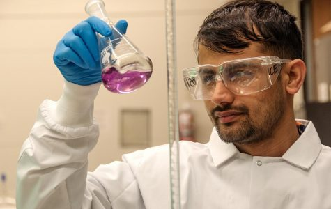 """Sudip Baral, an international, second-year master's student from Nepal, prepares solutions for his thesis research Sunday, Oct. 25, 2020, in the Civil, Environmental, and Infrastructural Engineering department of the College of Engineering in Carbondale, Ill."""" I have been doing research using nanotechnology to convert biomass waste products into biofuels. This research will not only contribute help in the reduction of carbon dioxide gas but also make it economically sustainable,"""" Baral said."""