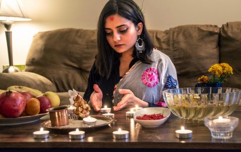 """Bristi Poudel, an international, second-year Ph.D. student in Biomolecular and Physiology, celebrates Nepal's largest Hindu festival in her apartment Thursday, Oct. 29, 2020, in Carbondale, Ill. """"I feel like missing home while celebrating the biggest festival, Dashain,"""" Poudel said."""
