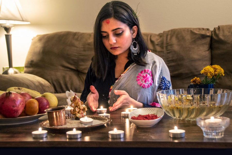 "Bristi Poudel, an international, second-year Ph.D. student in the Department of Physiology, celebrates Nepal's largest Hindu festival in her apartment Thursday, Oct. 29, 2020, in Carbondale, Ill. ""I feel like missing home while celebrating the biggest festival, Dashain,"" Poudel said."