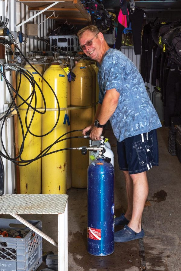 David Shepard, who is in the process of becoming a staff member, finishes filling air tanks Thursday, Oct. 22, 2020. To be on staff at Mermet Springs, people have to volunteer for one or two years to ensure that they are dedicated and want to be on staff.