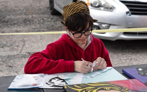 """Gabby Johnson works on her spray paint art while she sells her acrylic pop paintings and photos at the Fall Crafts and More Vendor Fair on Saturday, Oct. 3, 2020, in Marion ILL. Johnson said, """"COVID-19 has been tough on a lot of business photography because weddings are being cancelled so I have been offering discounts,"""" Johnson's photography business is called Sublime Photography."""