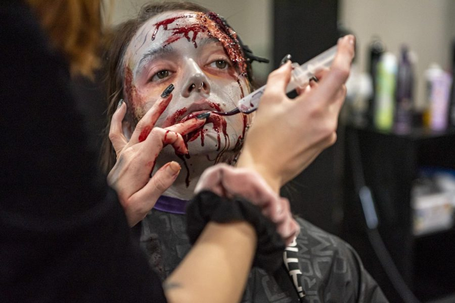 Kirstan Innis sits for a Halloween themed make-up demonstration by her friend, Stephanie Jines Wednesday, Oct. 28, 2020, in Carterville, Ill.