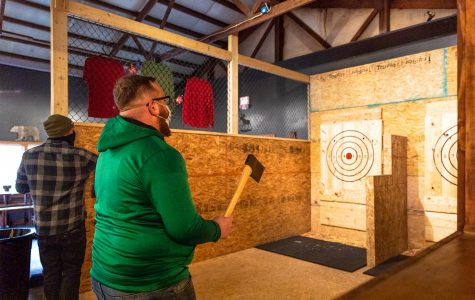 Matt Ahlfield and Isaac Gibson, co-owners of Backwoods Axe Throwing in Murphysboro, practice their axe throwing Thursday, Oct. 29, 2020.
