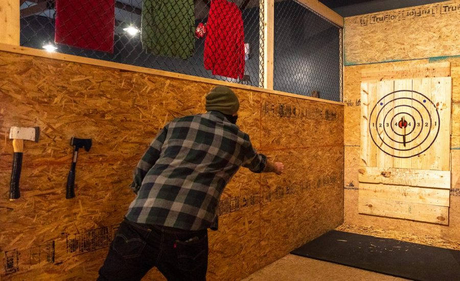 Isaac Gibson, co-owner of Backwoods Axe Throwing in Murphysboro, Ill., practices his axe throwing Thursday, Oct. 29, 2020.