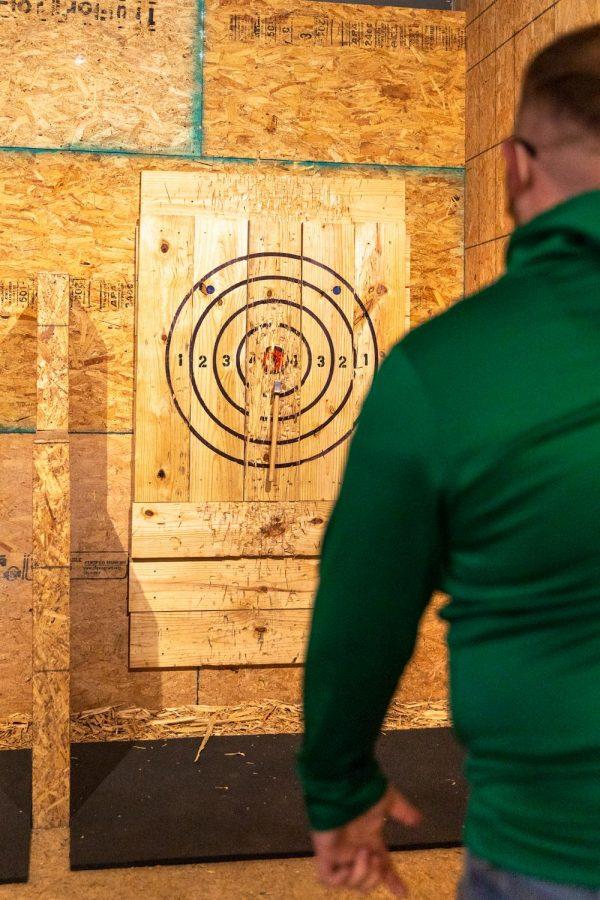 Matt Ahlfield, co-owner of Backwoods Axe Throwing in Murphysboro, Ill., practices his axe throwing Thursday, Oct. 29, 2020.