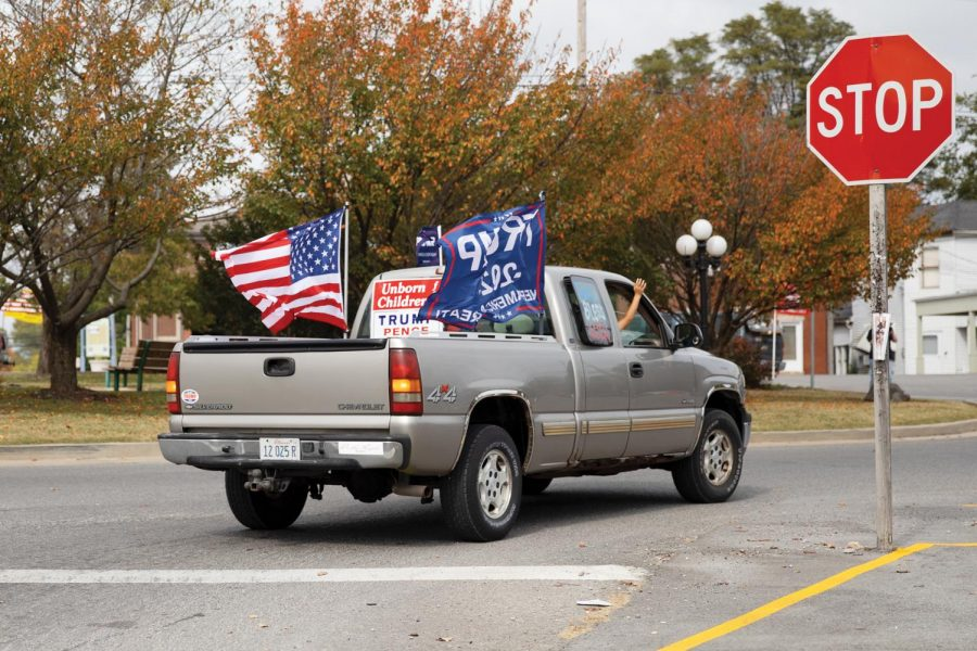 A Trump supporter follows the Trump Train around the roundabout off of hwy. 127 and hwy. 146 in Jonesboro, Ill., on Saturday, Oct. 10, 2020.