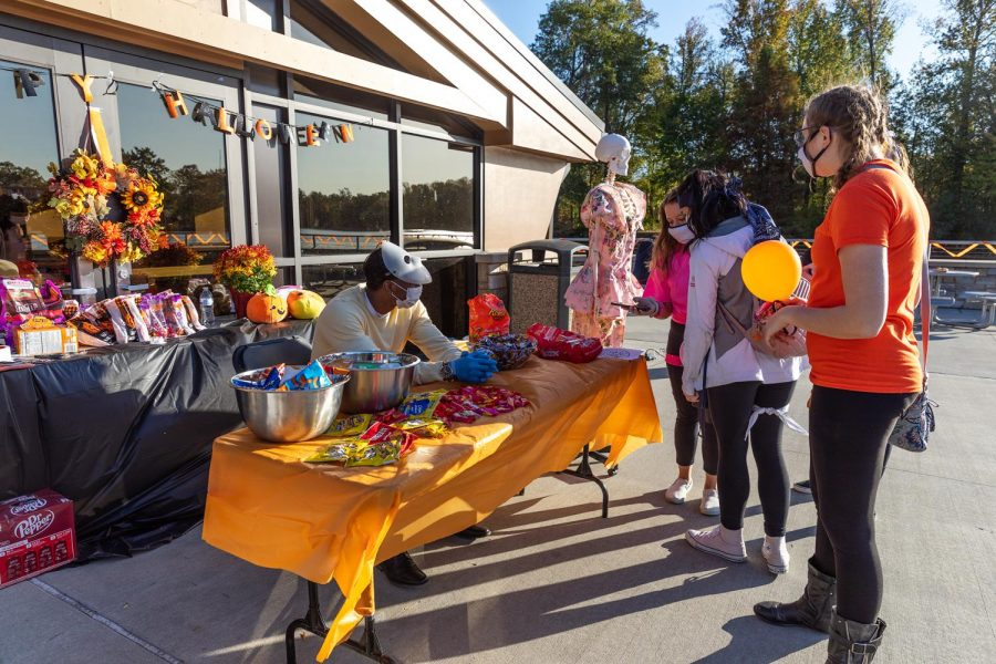University Honors Assembly President, Martiece Arrington helps hand out snacks at the Moon Light on the Lake event hosted by the Honors Assembly Saturday, Oct. 17, 2020.