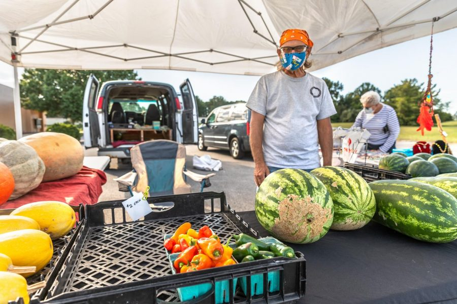 Richard Bochantin, DuBois, ILL., sells a variety of watermelons, spaghetti squash, pumpkins, and peppers at the Humpday Farmer's Market on Wednesday, Sept. 30, 2020, in Carbondale, ILL.