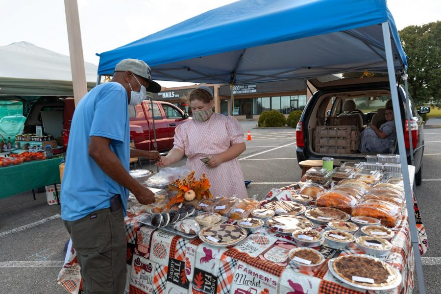 Marla Biller sells homemade baked goods at the Humpday Farmer's Market on Wednesday, Sept. 30, 2020, in  Carbondale, ILL. Biller and her family, along with some family friends, bake all of the baked goods that get sold at their stand at the farmer's market. Biller said that her favorite of the pies was the pecan pie.