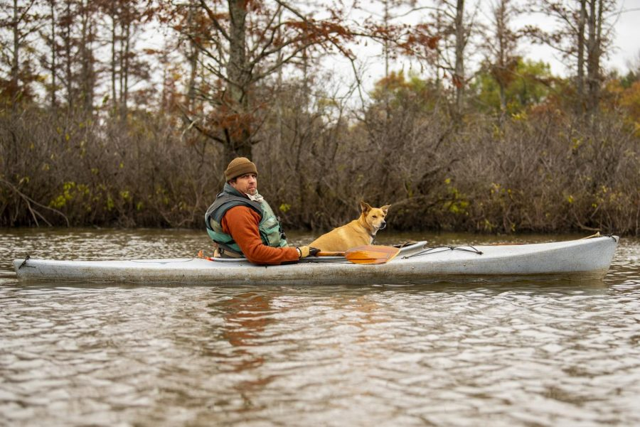 Mark Denzer, operator of Cache Bayou Outfitters, paddles his way through the Cache River Oct. 24, 2020 outside of Ullin, Ill. Cache Bayou Outfitters is a kayak and canoe rental service that also offers tours of the Cache River.  As the seasons changing from fall to winter, many outdoor recreational businesses will be closing until spring. Cache Bayou Outfitters will ending their season this Saturday on Halloween.