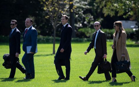 In this file photo, (L-R) Assistant to the President and Director of Oval Office Operations Nicholas Luna, Assistant to the President and Deputy Chief of Staff for Communications Dan Scavino, Senior Advisor to the President of the United States Jared Kushner, Senior Advisor to the President Stephen Miller, and counselor to President Hope Hicks walk to Marine One to depart from the South Lawn of the White House in Washington, DC on September 30, 2020.