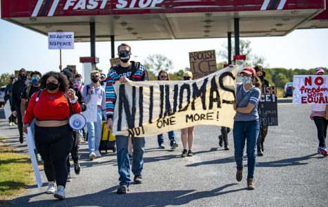 A group of protesters marches towards the Pulaski County Detention Center on Saturday, Oct. 3, 2020, in Ullin, IL. The facility is operated by ICE. The protest was put on by the Southern Illinois Immigrant Rights Project and Midwest Council for Civil Rights. The goal was to demand health inspections for inmates.