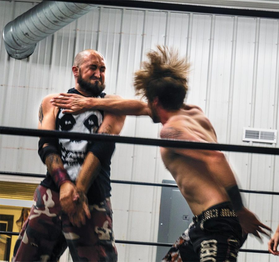 """Dalton Diamond braces for an incoming chop from Zakk Sawyers on Saturday, Sept. 12, in Carterville, ILL. Diamond and Sawyers have been preparing for their debut event for over a year, and have utilized the connections they've made in the wrestling business to ensure they can book the talent they want. """"A lot of the talent I've booked I've known personally. I've known these guys for a lotta years some of them, some I've never worked with before but I know they have  great potential. Everybody is working to produce a great artistic product. You're gonna see hard-hitting abrasiveness, violence, and bloodshed for the sake of bloodshed outta these guys,"""" Sawyers said."""