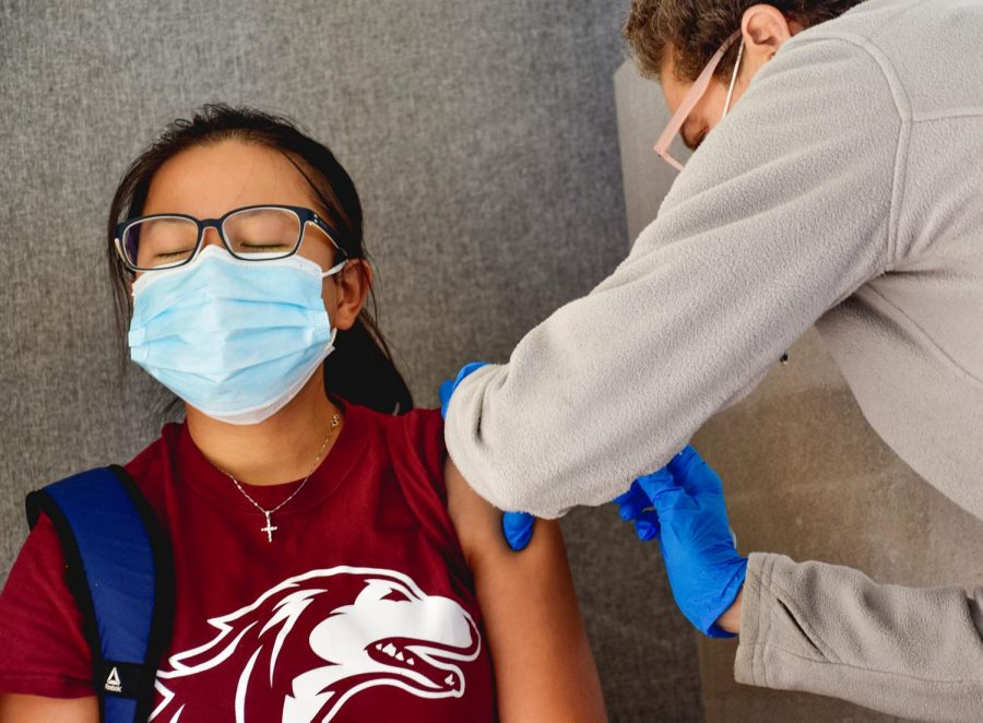 """Yuening Zhao, a second year PhD student, gets a flu shot at the SIU Health Center Flu Shot Clinic Friday, Oct. 16, 2020, at the Student Services Building in Carbondale, Ill. """"I never had a flu shot ever since I became an adult. This year, I feel like because a lot of the COVID symptoms might be similar to a regular flu, I was thinking just in case,"""" Zhao said.  As flu season approaches researchers are worried there will be peaks of flu and COVID-19 cases at the same time according to UCSF.edu."""