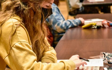 """Maria Cavral, a freshman, plays """"Spooky Saluki Bingo"""" in the Student Center Oct. 28, 2020, in Carbondale Ill. """"I came to this because I was tired of being in the dorms and this was something to do and have fun with friends,"""" Cavral said."""