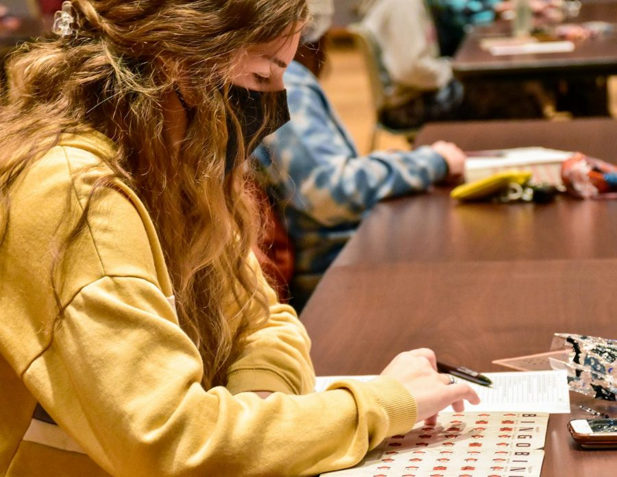 "Maria Cavral, a freshman, plays ""Spooky Saluki Bingo"" in the Student Center Oct. 28, 2020, in Carbondale Ill. ""I came to this because I was tired of being in the dorms and this was something to do and have fun with friends,"" Cavral said."