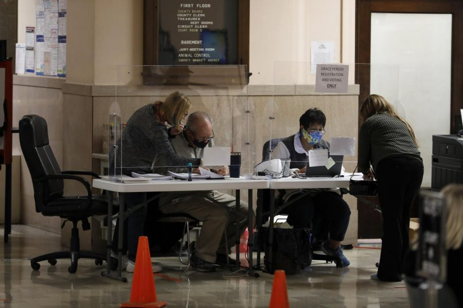 Poll workers help last-minute voters at the Jackson County Courthouse in Murphysboro on election day, Tuesday, Nov. 3, 2020.