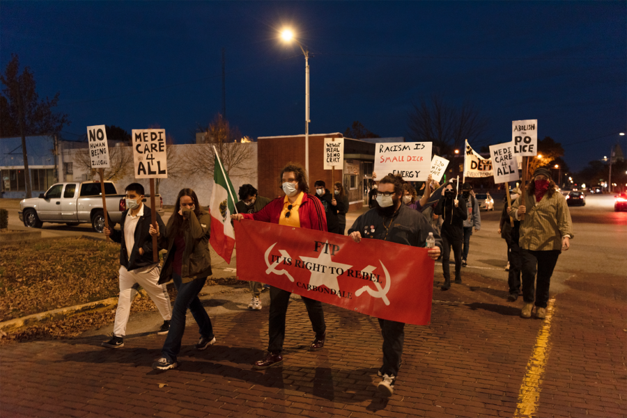 Citizens of Carbondale march in support of social justice the day after the general election Wednesday, Nov. 4, 2020, in Carbondale, Ill. Several local activist groups attended, including For the People, a communist organization dedicated to helping those in need within local communities through various food and clothing drives.