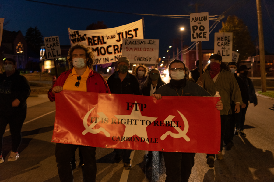 Citizens of Carbondale march in support of social activism a day after the election  Wednesday, November 4, 2020, in Carbondale, Ill. Several local activist groups attended, including For the People, a communist organization dedicated to helping those in need within local communities through various food and clothing drives.