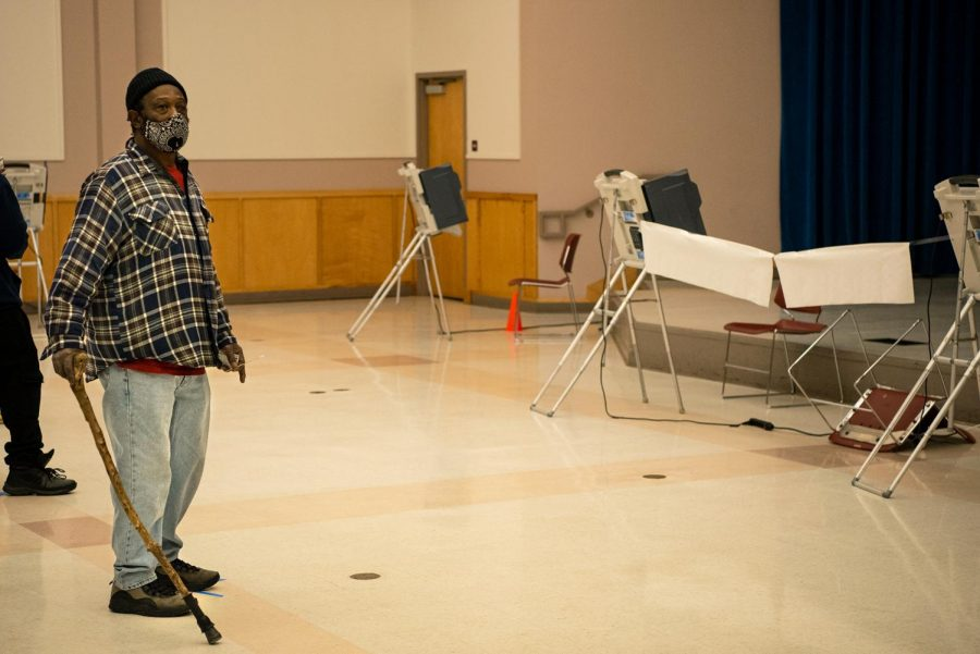 Voter Percy Wallace patiently waits for voting machines to come online Tuesday, November 3, 2020, in Carbondale, Ill. At 70 years old, Wallace is an experienced voter and eagerly accepted the offer from poll workers to wait in line for the polling machines to become operational.