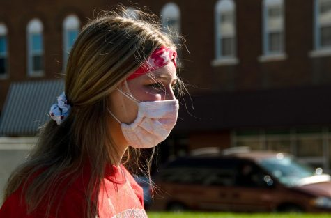 """Alara Pfeaster, 18, walks outside of the Jackson County Courthouse in Murphysboro Ill., Tuesday, Nov. 3, 2020. """"This is my first time [to vote]. I think it"""