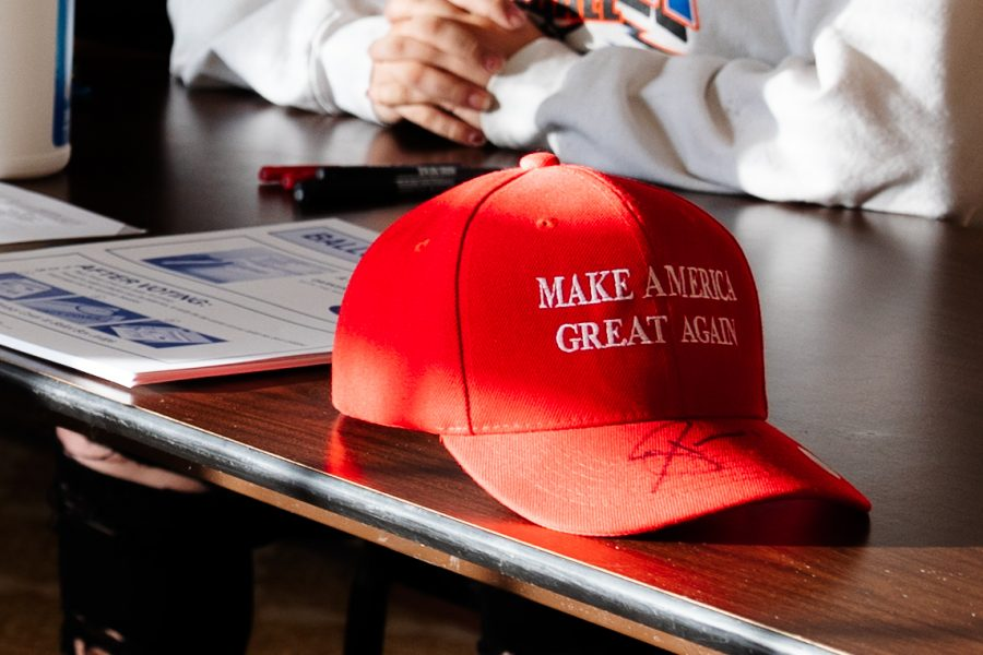 A Trump 'Make America Great Again' hat sits on the ballot table where a voter was asked to remove it due to the state law for election petitioning that you can campaign within 100 feet of a polling place Tuesday, Nov. 3, 2020, in Belknap, Ill.
