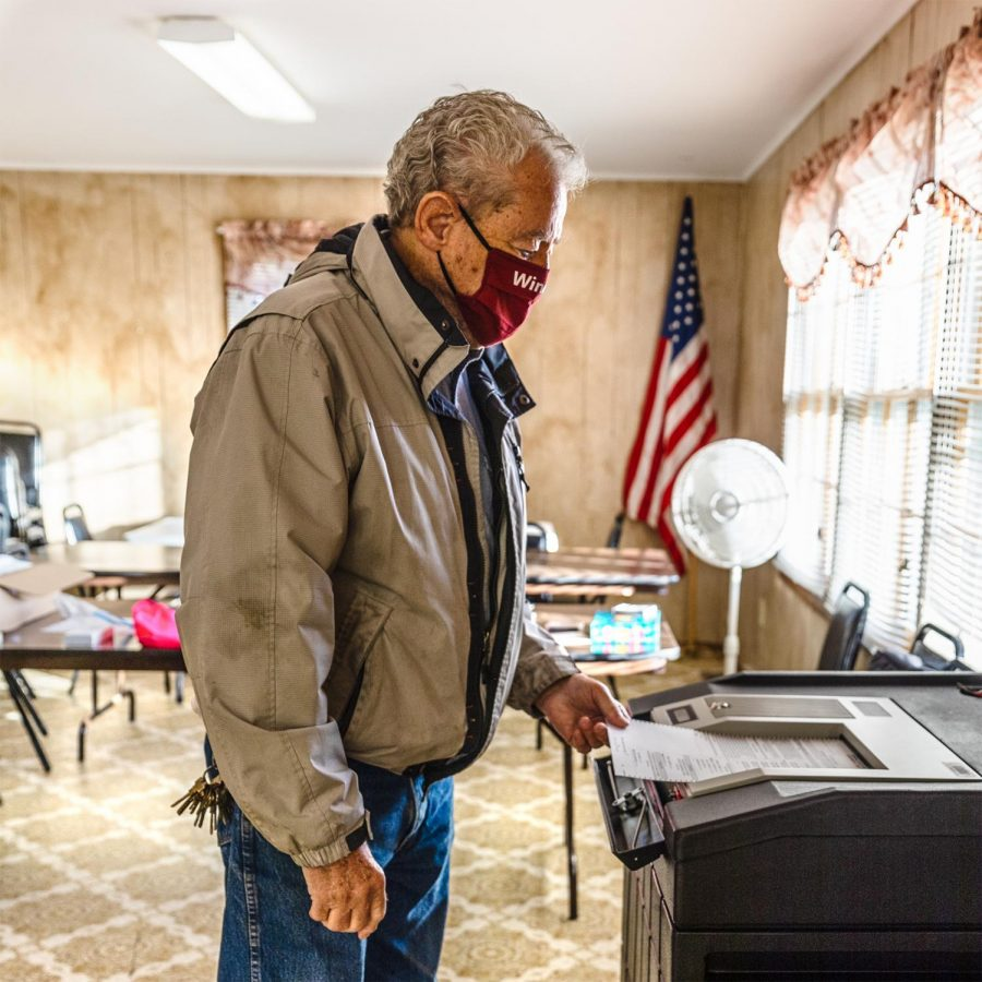 Jack Dunker, owner of Cache River Basin Vineyard and Winery in Belknap, Ill., submits his ballot Tuesday, Nov. 3, 2020, in Belknap, Ill.