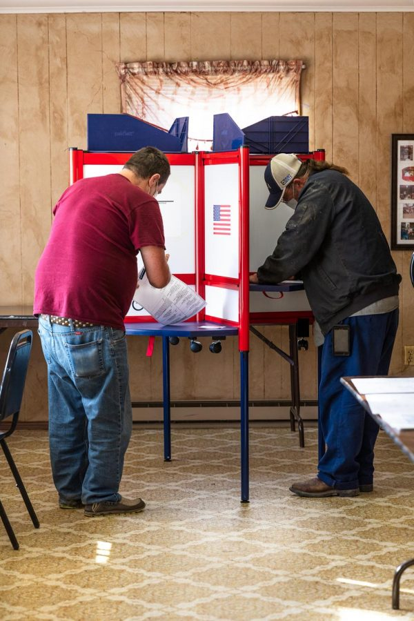 Mike Cullison and his brother, Tony Cullison, fill out their ballots Tuesday, Nov. 3, 2020. Mike and Tony both live in Belknap, Ill. and Mike is the owner of Mike's Saw Shop in Belknap, Ill.