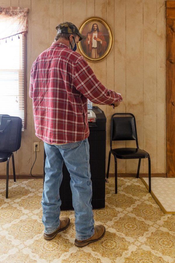 Steve Barnes submits his ballot at the Senior Center in Belknap, Ill. Tuesday, Nov. 3, 2020.