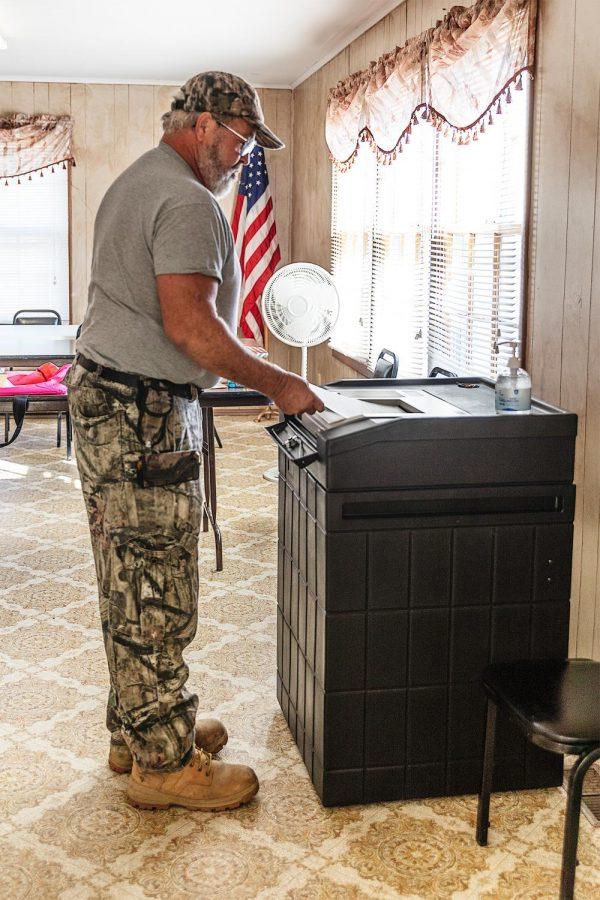 David Hester submits his ballot at the Senior Center in Belknap, Ill. Tuesday, Nov. 3, 2020.