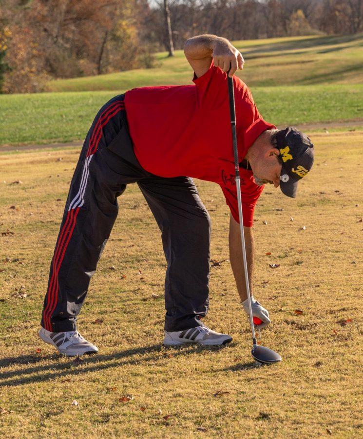 Randy Hammersley, a U.S. veteran, prepares to tee off on Veteran's Day at the Keller's Crossing at Stone Creek Golf Course in Makanda, Ill., Wednesday, Nov. 11, 2020.