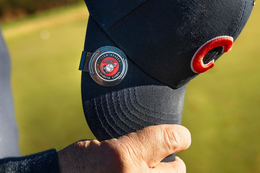 Rodney Miller, 15 year Marine Corps veteran, wears his Marine Corps pin during a free game of golf for veterans on Veteran's Day at the Keller's Crossing at Stone Creek Golf Course in Makanda, Ill., Wednesday, Nov. 11, 2020.