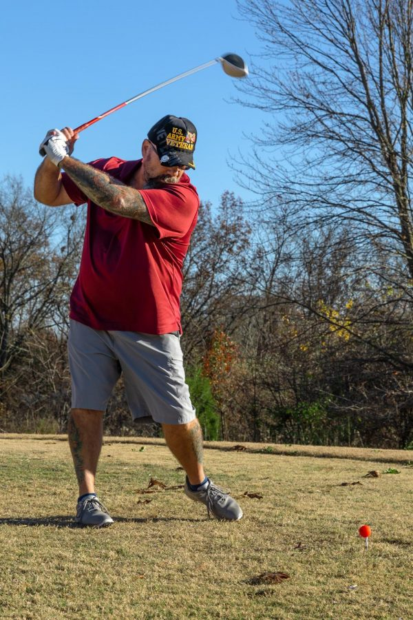 Dan Pender, a four year Army veteran, tees off on Veteran's Day at the Keller's Crossing at Stone Creek Golf Course in Makanda, Ill., Wednesday, Nov. 11, 2020. Each year on Veteran's Day, owners and veterans Tim Chrzan and his son Jason, host a veterans golf free event to honor those who have served their countries.