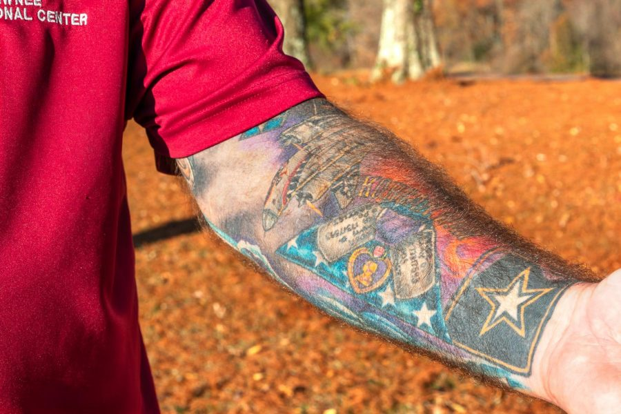 Dan Pender, U.S. Army veteran, shows his tattoo sleeve in memory of his father and to honor active and inactive service members on Veteran's Day at the Keller's Crossing at Stone Creek Golf Course in Makanda, Ill., Wednesday, Nov. 11, 2020.