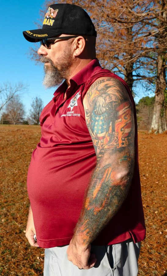 Dan Pender shows his tattoo sleeve in memory of his father and to honor active and inactive service members on Veteran's Day at the Keller's Crossing at Stone Creek Golf Course in Makanda, Ill., Wednesday, Nov. 11, 2020.