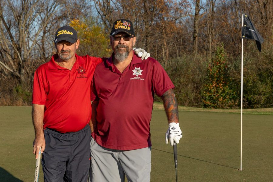 Randy Hammersley, left, and Dan Pender, right, pose for a portrait on Veteran's Day at the Keller's Crossing at Stone Creek Golf Course in Makanda, Ill., Wednesday, Nov. 11, 2020. Each year on Veteran's Day, owners and veterans Tim Chrzan and his son Jason, host a veterans golf free event to honor those who have served their countries and their families.