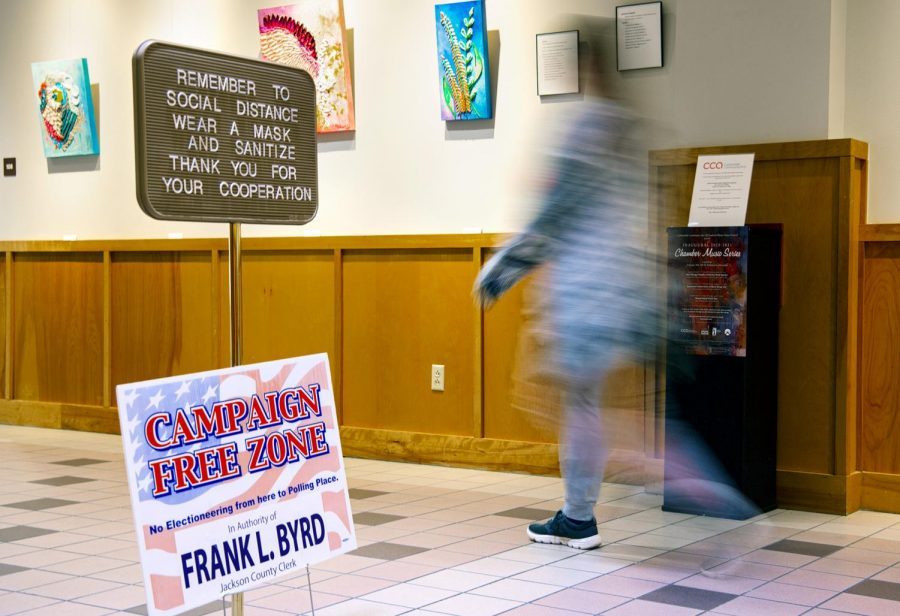 A voter passes election day signage placed inside the Carbondale Civic Center Nov. 3 in Carbondale, Ill.