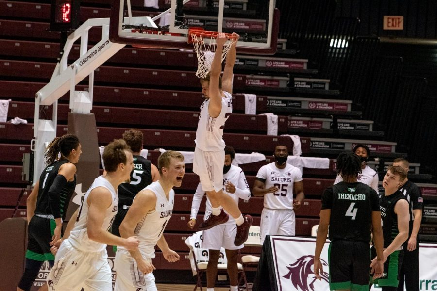 Anthony Avanzo dunks a shot during the SIU vs. North Dakota game Friday, Dec. 18, 2020, at the SIU Bantera Center in Carbondale Ill. SIU won with a final score of 62 to 50.