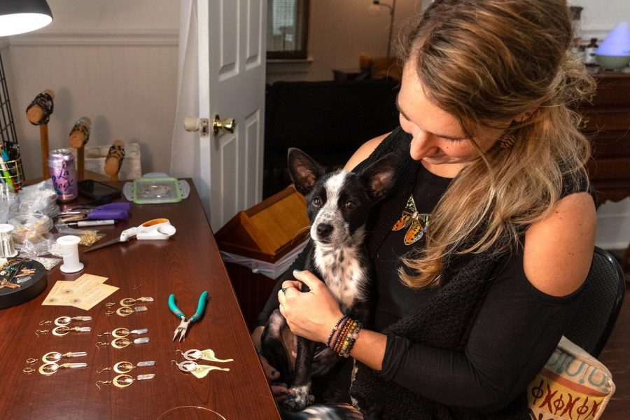 Molly Gabel sits with her dog, Amaya, in her at-home studio Monday, Sept. 28, 2020, in Carbondale Ill. Amaya is an aussie doodle heeler and