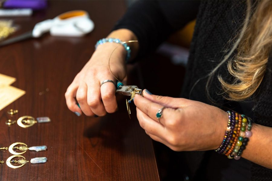 Molly Gabel works on some earrings in her at-home studio Monday, Sept. 28, 2020, in Carbondale Ill. Gabel averages six to twelve pieces each day. She loves mixing colors and using gemstones and various metals with the wings.