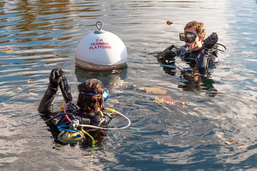 """Crosby Gardner, 24, completes his ninth dive with instructor Tish Kinseykautz Thursday, Oct. 22, 2020. Gardner graduated last year, 2019, with honors and a 3.10 GPA from the West Kentucky University Autism School. He had been chosen out of 80,000 applicants for one of five seats at the school. """"When I was first diagnosed with autism, I was four years old and they told me that I would never walk, that I would never have balance, that I would never drive, that my life would be shit and I proved them wrong when I graduated [from the West Kentucky University Autism School],"""" Gardner said. He had been talked into trying scuba diving by a friend and has been diving since September 29, 2020."""