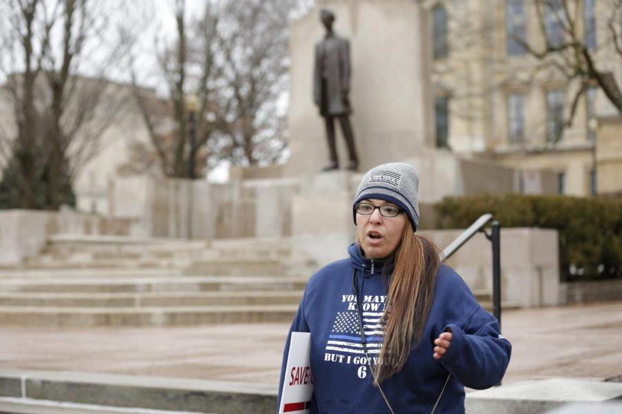 Ashley Ramos, a member of the nonprofit organization Back the Blue, which supports members of law enforcement and first responders, stands outside of the Illinois State Capitol building, protesting the recently signed police reform bill, Springfield, IL, Saturday, January 16, 2021.
