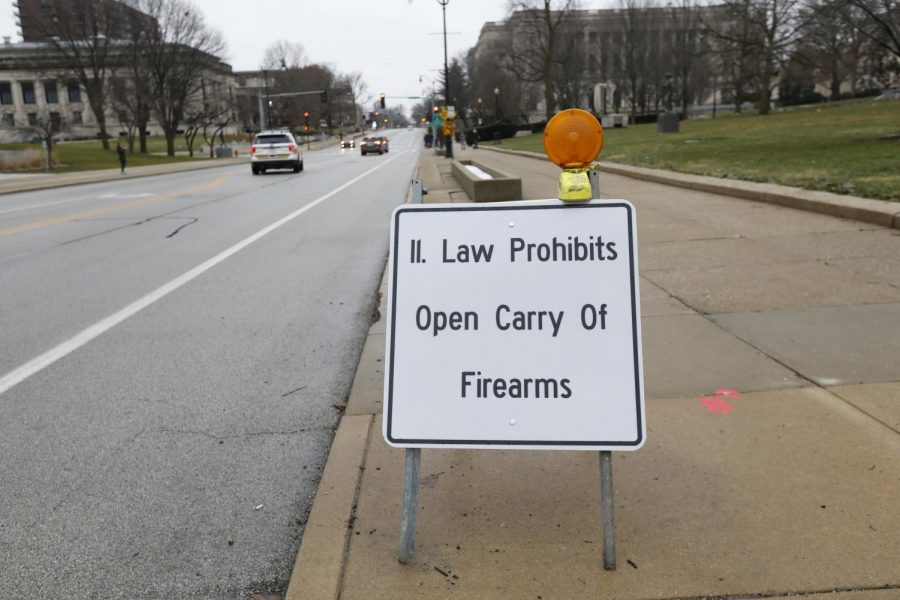 """A sign outside fo the Illinois State Capitol building reminding citizens that """"Illinois Law Prohibits Open Carry of Firearms,"""" Springfield, IL, Saturday, January 16, 2021."""