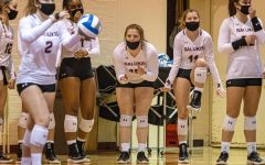 The SIU volleyball bench gets hyped as freshman MacKenzie Houser prepares to serve against Missouri State on Saturday, Jan. 30, 2021 in  Davies Gym at SIU. The Salukis would go onto to fall to the Bears 3-2 in the Salukis' first home game of the season.